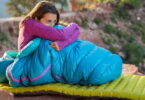 Woman relaxing outside in a sleeping bag