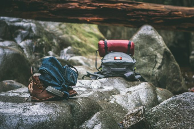 Extra clothes and food in a backpack on a rock