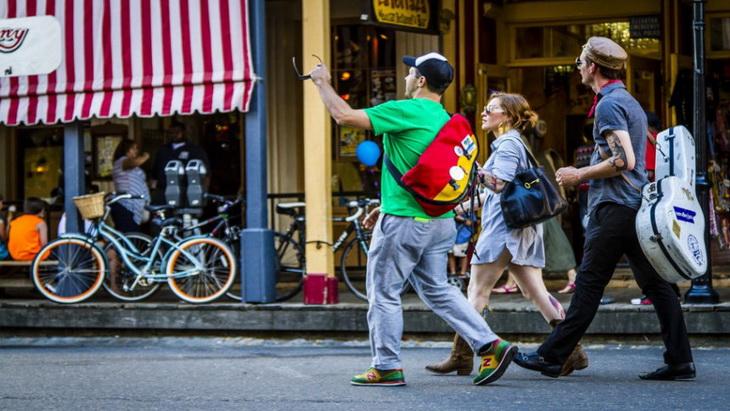 travelers walking down the street