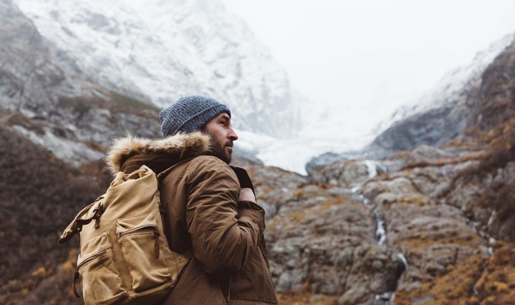 Man-with-backpack-trekking the mountains