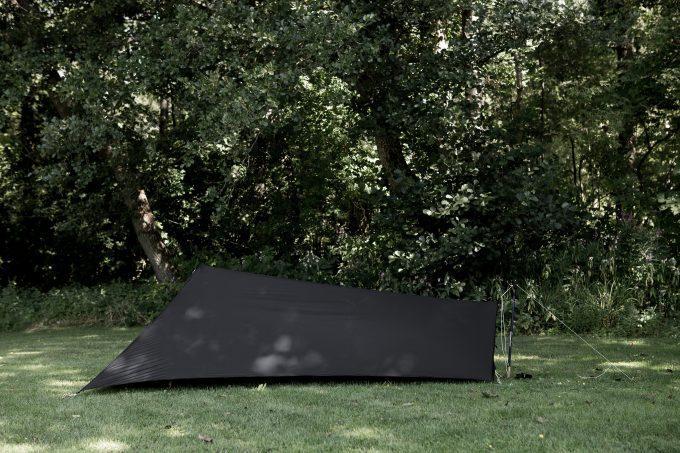 black-tarp-tent-on-grass-680x453