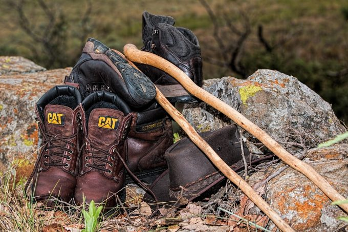 A cat boots, hat, backpack and hiking sticks