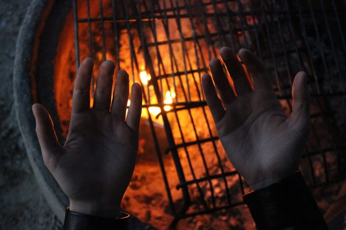 Testing fire with hands