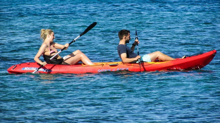 Young couple having fun paddling