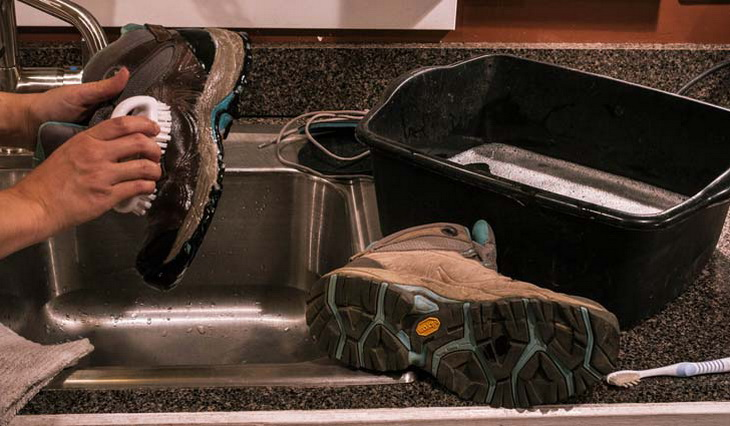 Man cleaning hiking boots