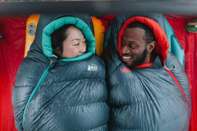 couple-in-synthetic-sleeping-bag