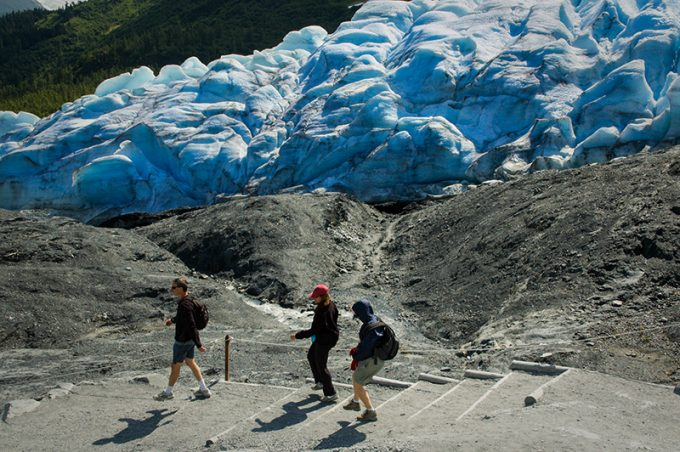 hiker on the edge of Exit Glacier