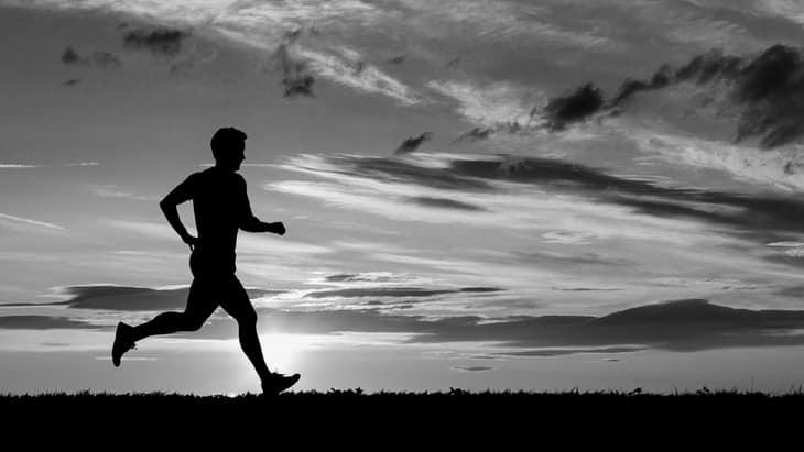 Man running before sunrise