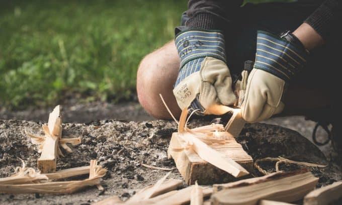 Man starting a campfire