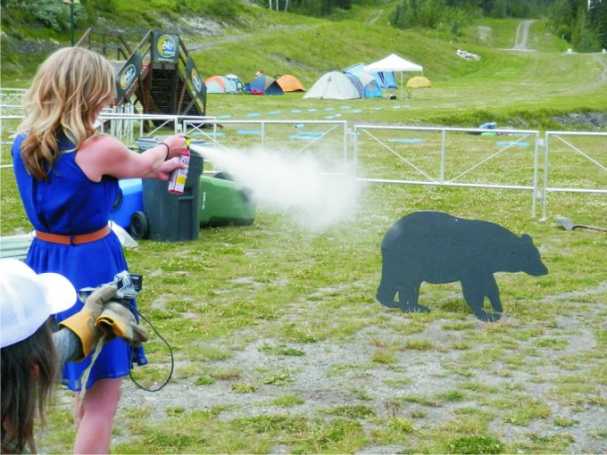 girls-repelling-bear-spray