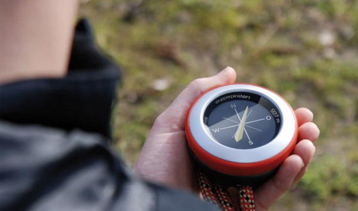 GPS with compass in hands of a person