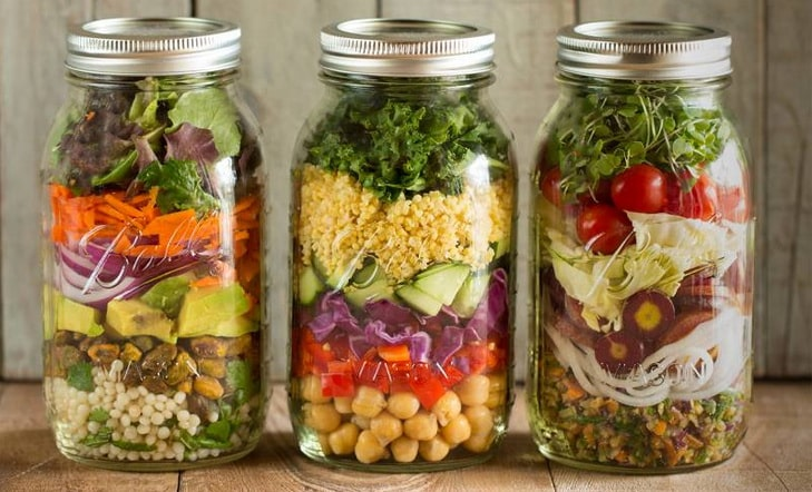 healthy salad in jars on the table