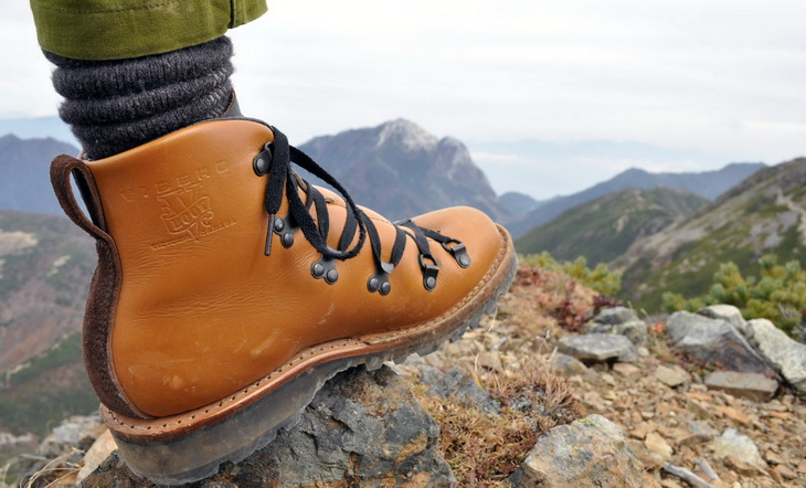 hiker wearing hiking boots and a landscape in the background