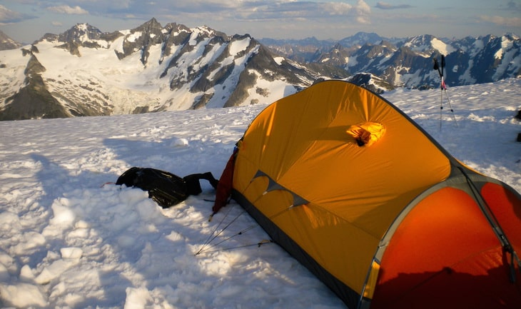 Tent above mountains