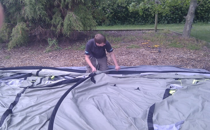 A man pitching a tent