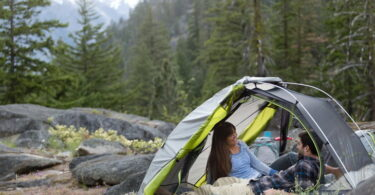Two adults camping with Kelty TN 2 Person Tent