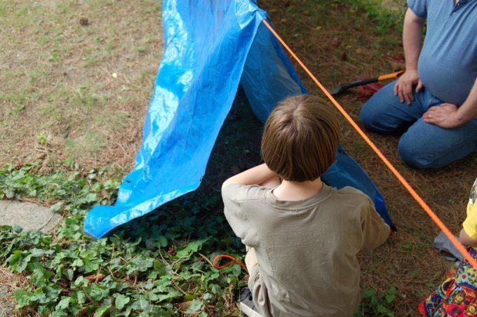 kid-and-dad-making-tarp-tent-