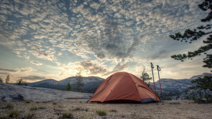a tent and a beautiful sunset