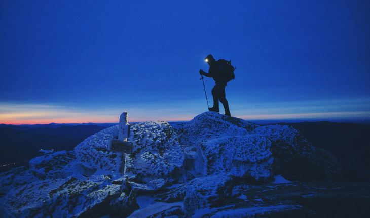 man hiking at night