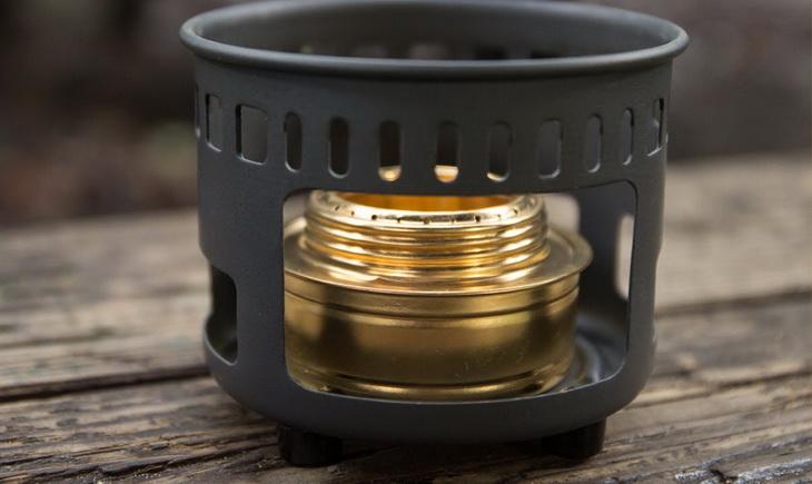 Esbit Brass Alcohol Burner on a wooden table