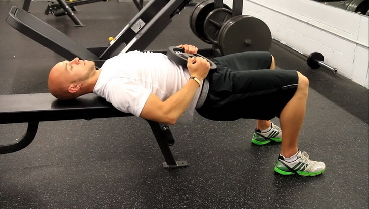 A Man Showing Bench Supported Glute Bridge Exercise