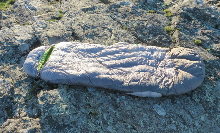 Nemo sleeping bag sitting on a rock outside