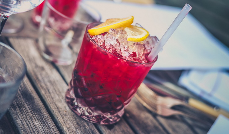 Red Drink on Clear Glass With Lemon on Top