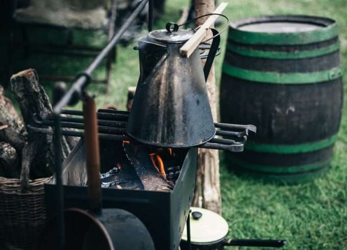 A campfire and a kettle full of water