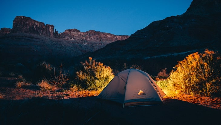 A tent outside in the nature during night time