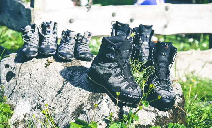 hiking boots on a rock in the sun during day time