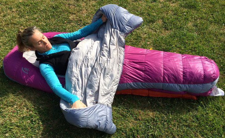 Woman laying down on the grass in Sierra Designs Backcountry Bed 600 3-Season