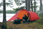 A man relaxing in a Hilleberg Anjan 2 Person Tent