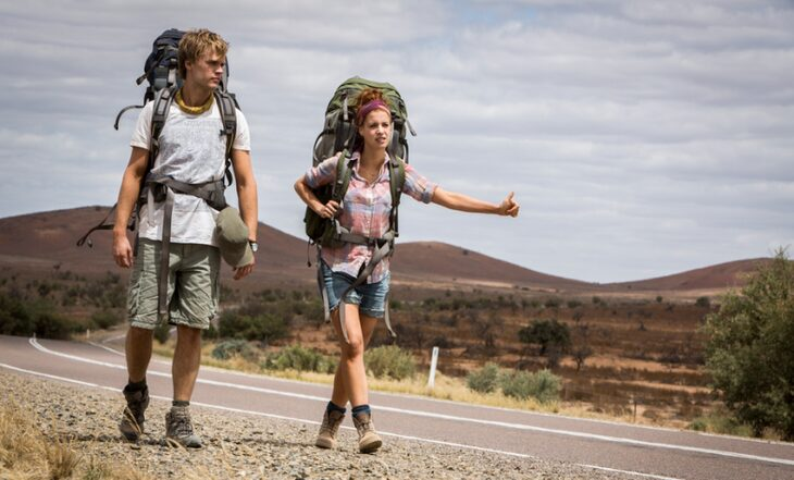 Backpackers near a river