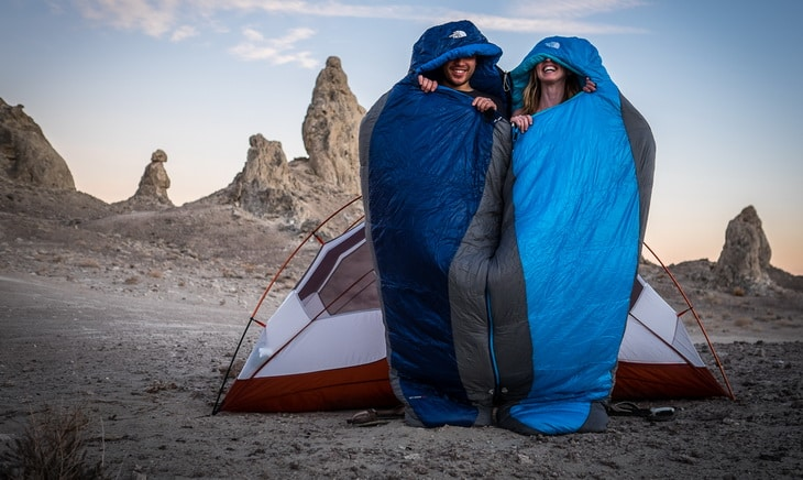 Two adults in sleeping-bags