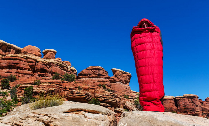 Man in a sleeping bag in the canyon