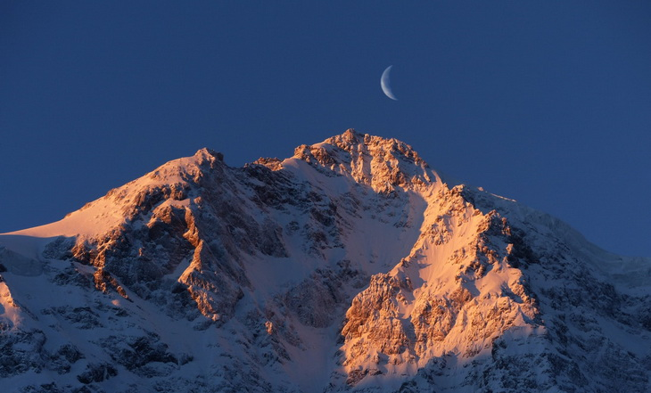 Crescent Moon over Snow Mountain