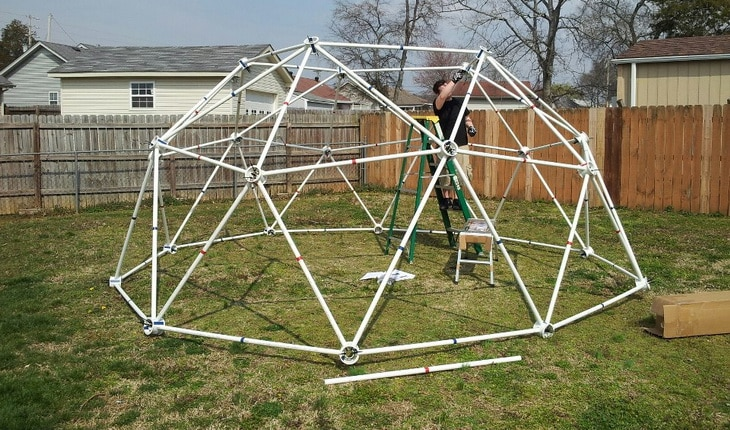 Man working on a homemade dome tent
