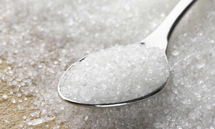 image of sugar in a spoon