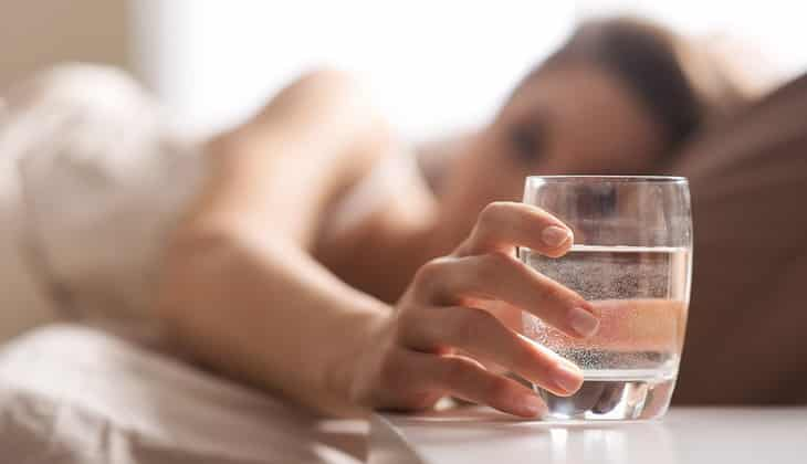 Woman getting hydrated before bedtime