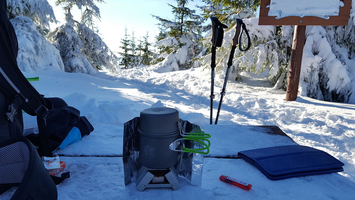 Preparing food while hiking in the winter