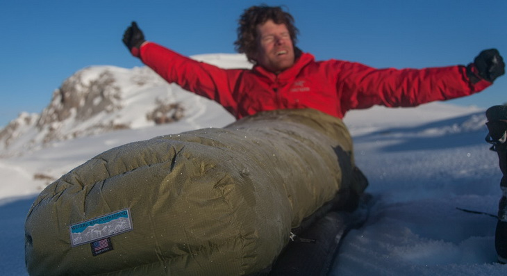Man in the morning in a Western Mountaineering Cypress sleeping bag