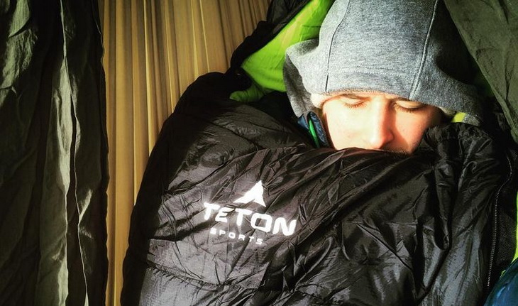 Man sleeping very well in a Teton Sports sleeping bag inside of a tent