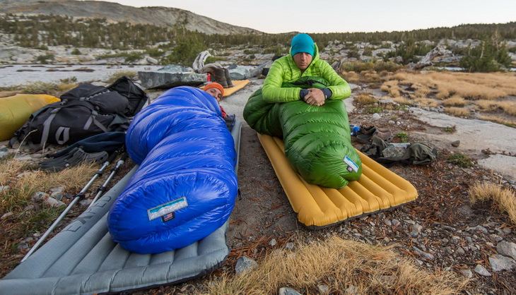Two adults in Western Mountaineering Cypress Gore sleeping bags