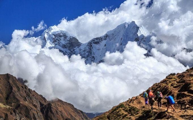 Hikers climbing a high mountain
