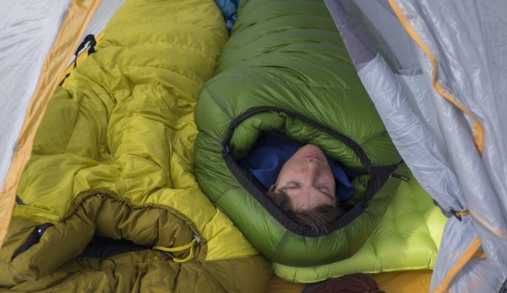 Man in a Western Mountaineering Kodiak sleeping bag