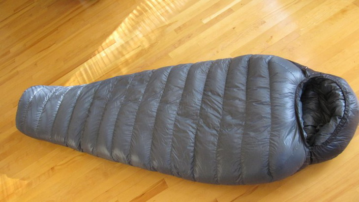 Western Mountaineering Kodiak sleeping bag laying on the floor in the house