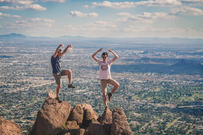 Two hiker over at the peak of Camelback Mountain's Echo Canyon