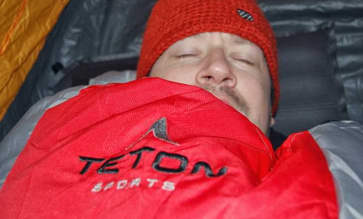 Man sleeping in Teton Sports sleeping bag