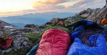 Man in a sleeping bag looking at the beautiful sky