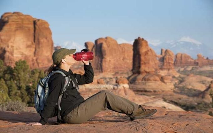 A hiker drinking water